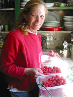smiling raspberry picker Toms Top Ten Reasons to Grow Raspberries